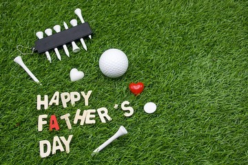 Happy Father's day to golfer with golf ball is on green grass