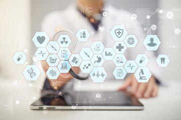 Medical doctor working with modern computer virtual screen interface. Medicine technology and healthcare concept.
