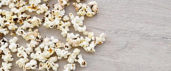 banner for website, popcorn on wooden background.