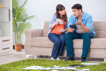 Young family in budget planning concept