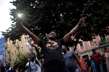 A recently arrived African migrant celebrates during a welcoming party organised by neighbourhood groups in Bilbao