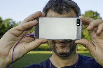 A man taking a photo with his smartphone