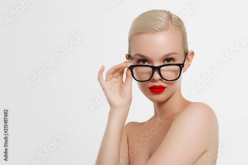 4047ba707 Beauty sexy fashion model woman portrait wearing glasses, isolated on white  background. Beautiful young blonde girl with trendy accessories posing in  studio