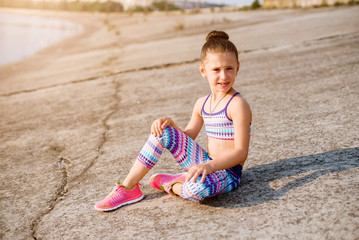 young sporty girl on her morning workout near river