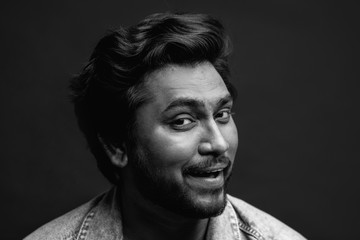 black and white photo. close up photo of man with playful face. flirting expression