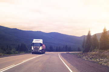 One the truck is moving on the mountain road