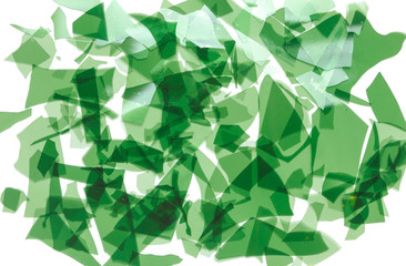 Green glass confetti. Fragments of very thin colored glass for fusing. Background image, texture