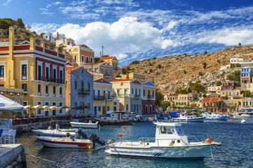 Scenic waterfront on the Greek island of Symi with bright and colorful fishing boats