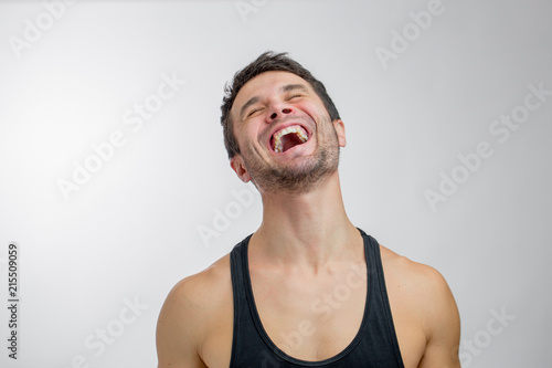 Young Man Is Laughing With Pleasure Angry Laugh Personal Trainer