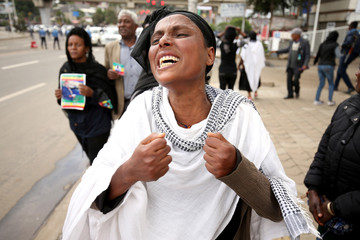 A woman reacts during the funeral ceremony of Simegnew Bekele EthiopiaÕs Grand Renaissance Dam Project Manager who was found dead in his vehicle on Thursday in Addis Ababa
