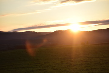 The sun setting in the mountains