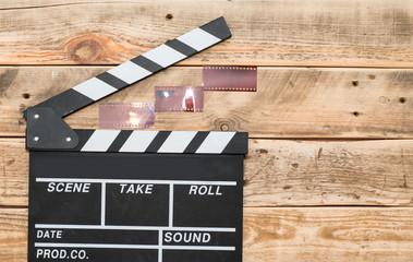Cinema clapper board and stripes of film