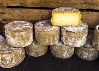 Stacked cheese loaves at the market of St Remy de Provence, Buches du Rhone, Provence, France.