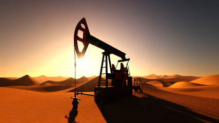 Oil pump in desert on sunset