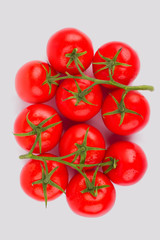 Bunch of fragrant tomato on white background. Top view. Isolated background.