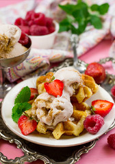 Belgian Liege waffles with strawberry ice cream and fresh berries