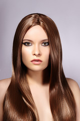 Beautiful yong Woman with Long Straight Brown Hair. Sexy Fashion Model with Smooth Gloss Hairstyle. Keratine Treatment