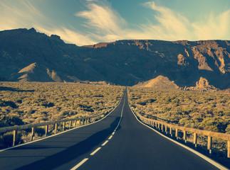 Retro stylized desert road.Travel adventure concept.