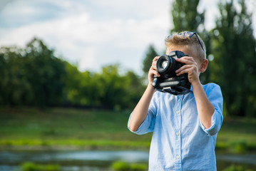 The boy picks up the nature of the camera