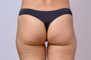 Trim toned buttocks of a slender fit woman