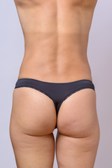 Rear of a fit slender woman with toned buttocks