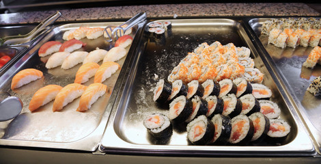 sushi on the trays of a Japanese restaurant