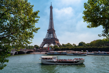 cruise ship in front of the Eiffel Tower