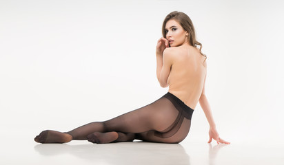 naked girl in pantyhose. isolated. on a white background.