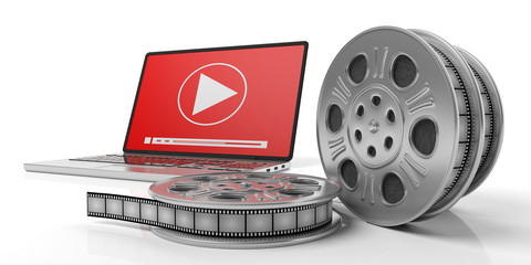 Film movie reels and a laptop on a white background, isolated, 3d illustration.