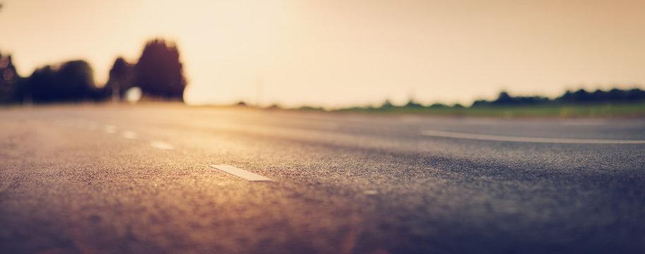 black asphalt road and white dividing lines