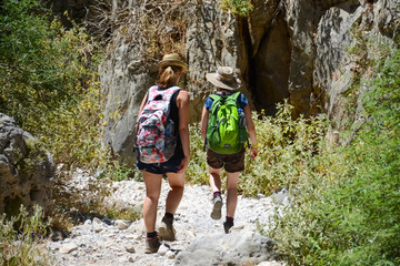 Tourists walk along the gorge of Imbros