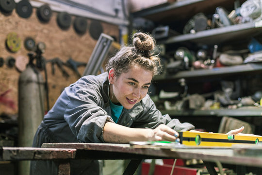 young woman working in workshop