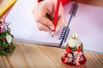 Girls hand writes the letter to Santa