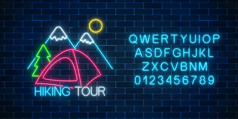 Neon hiking tour sign. Glowing web banner for summer camp, camping, nature tourism in neon style with alphabet.