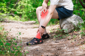 Pain in knee, joint inflammation, massage of male leg, injury while running, trauma during workout
