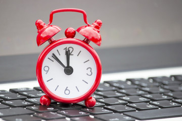 Red clock on the keyboard, lunch time