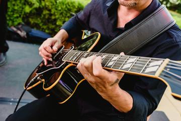Guitarist playing his guitar outdoors