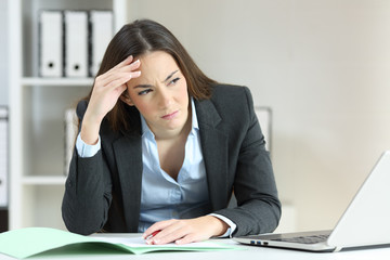 Worried office worker looking at side