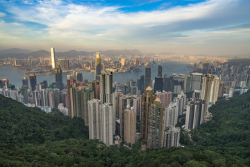 Hong Kong skyline an Victoria harbour at sunset seen from Peak Tower