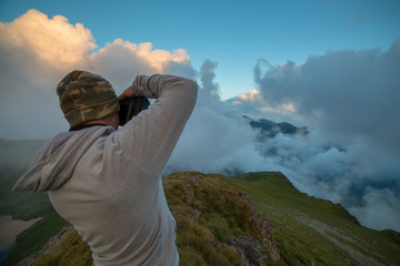 Photographer shooting landscape photos