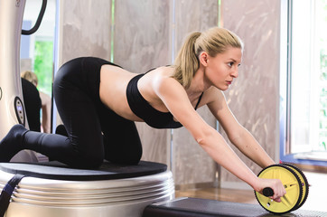 Girl training abs with roller