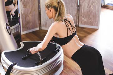 Girl doing push-ups on power plate