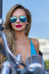 Brazilian Blonde Bikini Model Posing Outdoors With A Motorcycle