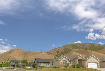 Suburban homes with hills behind and copy space