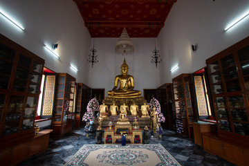 Wat Pho or Wat Phra Chetuphon buddhist temple . golden buddha statue sitting . old historic architecture in Bangkok Thailand