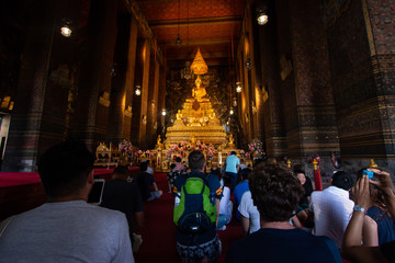 Bangkok, Thailand - Jul 9, 2018: Wat Pho or Wat Phra Chetuphon buddhist temple . golden buddha statue . old historic architecture . foreigner traveller go pray and worship .