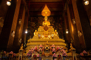 Wat Pho or Wat Phra Chetuphon buddhist temple . golden buddha statue sitting . old historic architecture in Bangkok Thailand , asian travel landmark