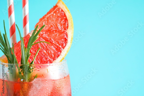 Refreshing cocktail of grapefruit with ice and rosemary on