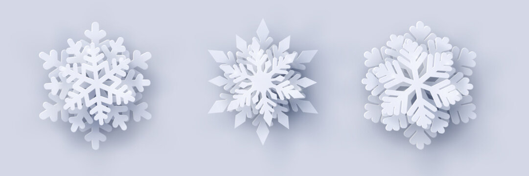 Vector set of 3 white Christmas paper cut 3d snowflakes with shadow on white background. New year and Christmas design elements