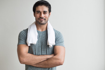 happy fitness man working out in gym; portrait of happy, smiling, positive asian indian man body training, working out in fitness gym; south asian, north indian adult man model